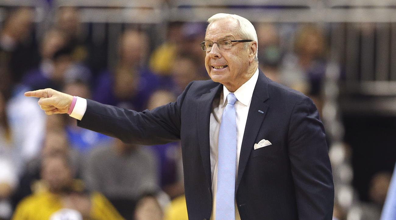 North Carolina head coach Roy Williams talks to his players during the first half of an NCAA college basketball game against Northwestern Monday, Nov. 23, 2015, in Kansas City, Mo. (AP Photo/Charlie Riedel)