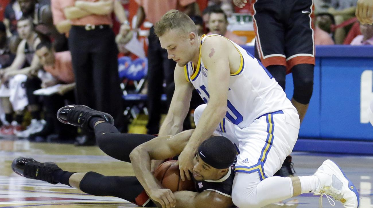 UNLV guard Jerome Seagears, bottom, battles with UCLA guard Bryce Alford, top, in the first half during an NCAA college basketball game in the first round of the Maui Invitational Monday, Nov. 23, 2015, in Lahaina, Hawaii. (AP Photo/Rick Bowmer)
