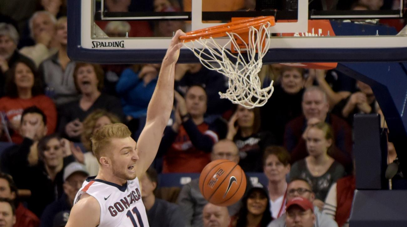 FILE - In this Nov. 21, 2015, file photo, Gonzaga's Domantas Sabonis (11) dunks over Mount St. Mary's BK Ashe (41) in the first half of an NCAA college basketball game, in Spokane, Wash. This year's Battle 4 Atlantis tournament bracket is anchored by thre