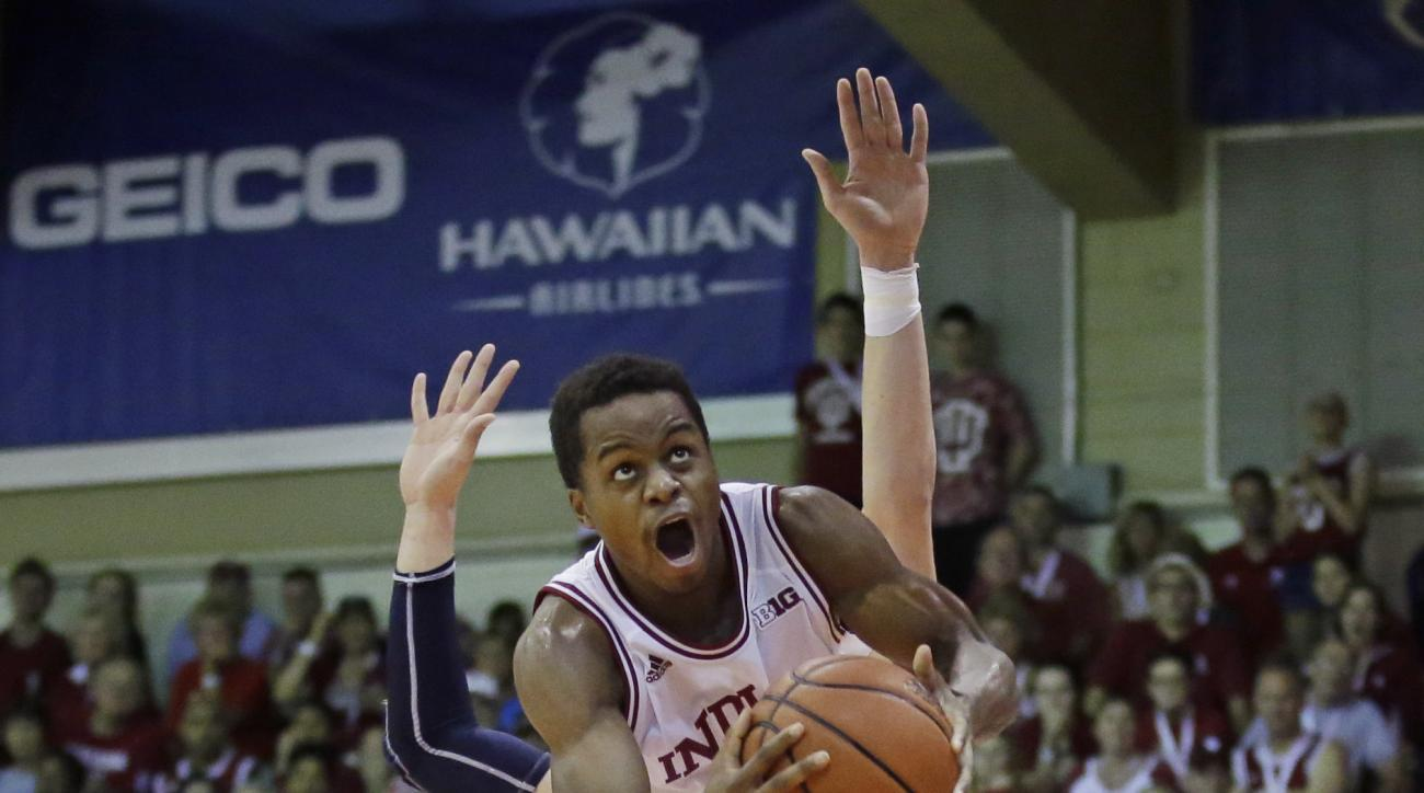 Indiana guard Yogi Ferrell (11) goes to the basket as St. John's forward Amar Alibegovic, rear, defends in the second half during an NCAA college basketball game in the second round of the Maui Invitational Tournament, Tuesday, Nov. 24, 2015, in Lahaina,
