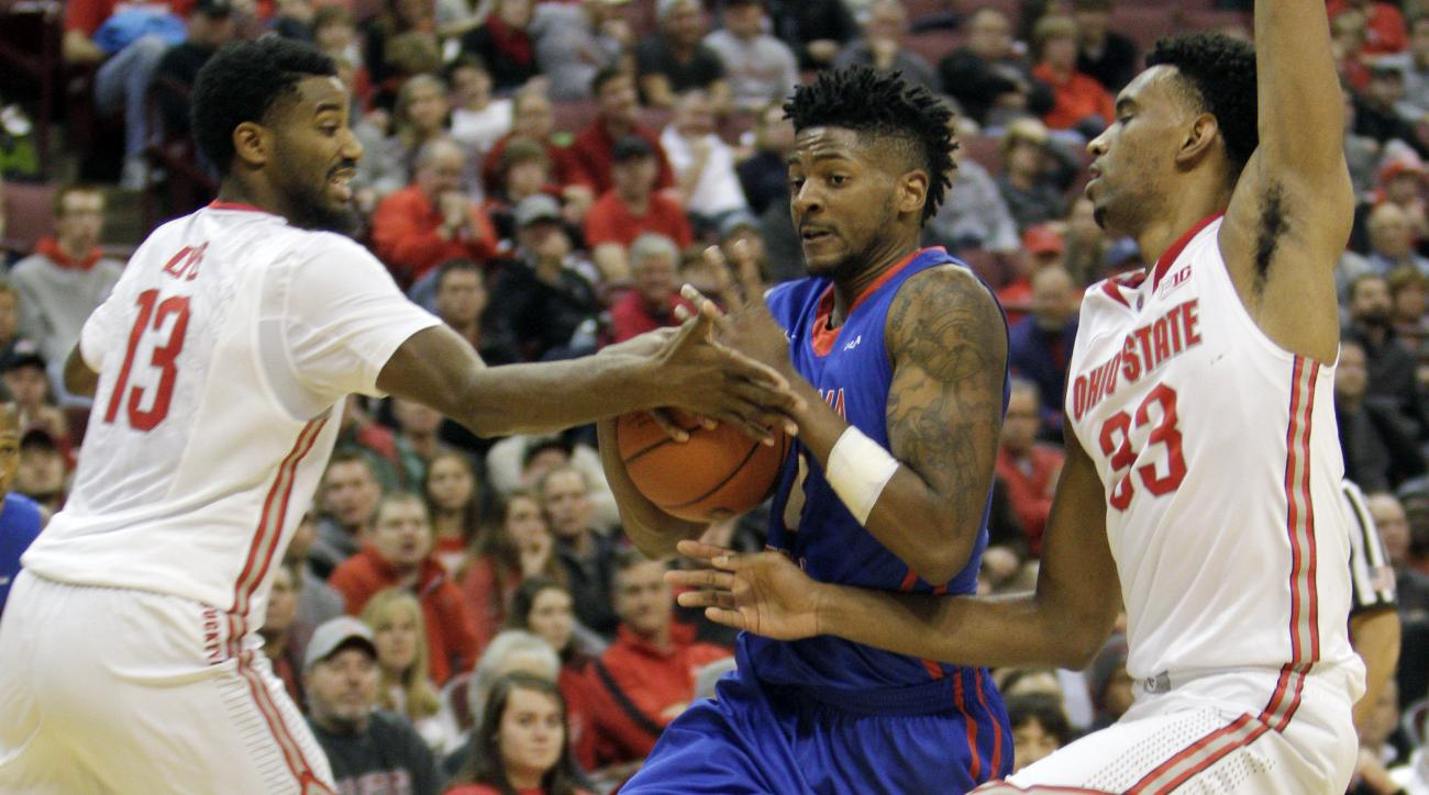 Louisiana Tech's Alex Hamilton, center, drives to the basket between Ohio State's JaQuan Lyle, left, and Keita Bates-Diop during the second half of an NCAA college basketball game Tuesday, Nov. 24, 2015, in Columbus, Ohio. Louisiana Tech beat Ohio State 8