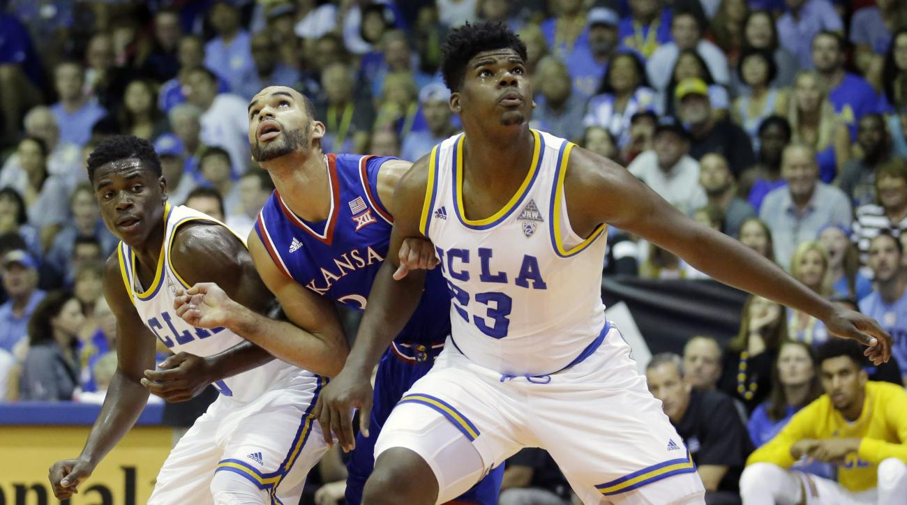 Kansas forward Perry Ellis, center, battles with UCLA's Aaron Holiday, left, and Tony Parker (23) for a rebound in the first half during an NCAA college basketball game in the second round of the Maui Invitational, Tuesday, Nov. 24, 2015, in Lahaina, Hawa