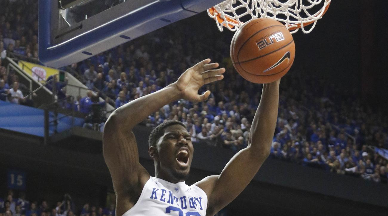 Kentucky's Alex Poythress dunks during the second half of an NCAA college basketball game against Boston University Tuesday, Nov. 24, 2015, in Lexington, Ky. Kentucky won 82-62. (AP Photo/James Crisp)