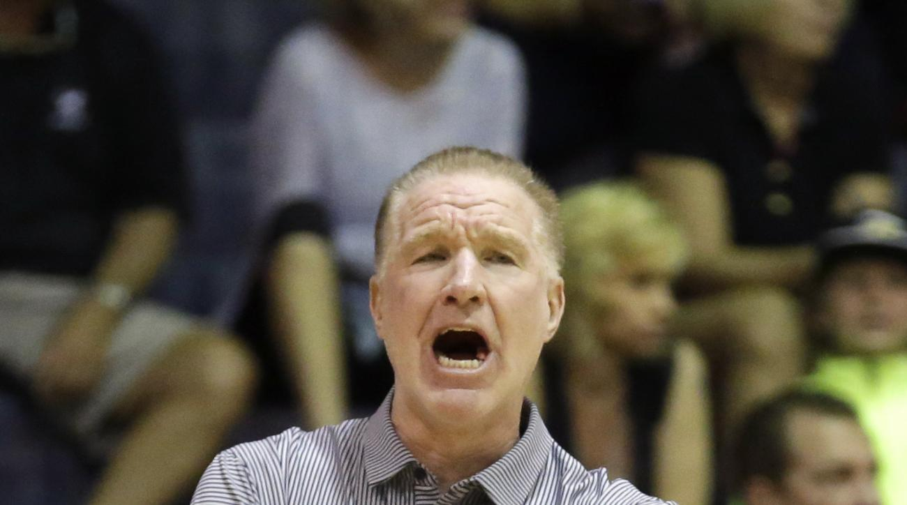 St. John's head coach Chris Mullin shouts to his team in the first half during an NCAA college basketball game against Chaminade in the Maui Invitational Wednesday, Nov. 25, 2015, in Lahaina, Hawaii. (AP Photo/Rick Bowmer)