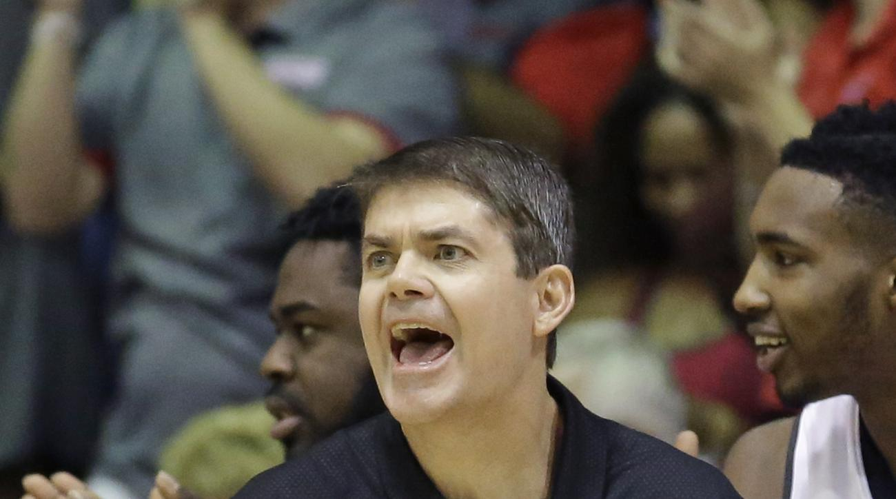 UNLV head coach Dave Rice shouts to his team in the first half during an NCAA college basketball game against Indiana in the Maui Invitational Wednesday, Nov. 25, 2015, in Lahaina, Hawaii. (AP Photo/Rick Bowmer)