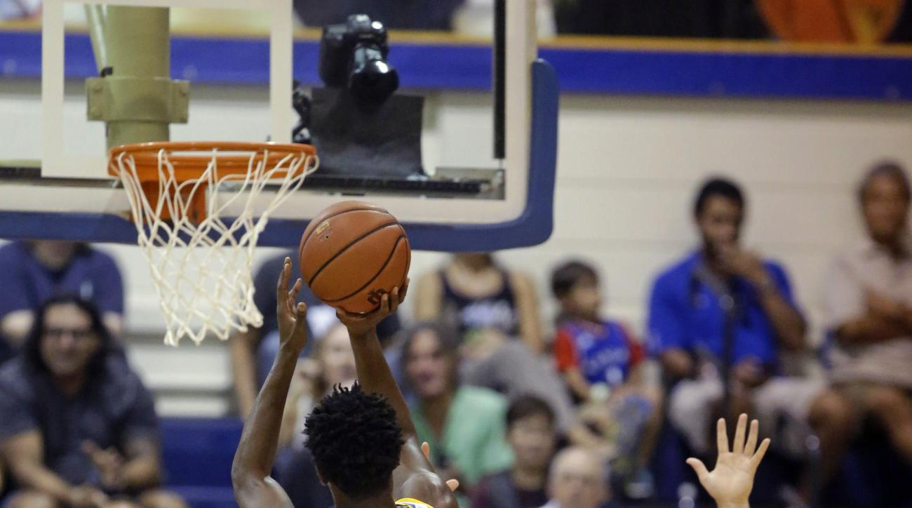 UCLA guard Isaac Hamilton (10) shoots as Wake Forest guard Trent VanHorn (43) defends in the first half during an NCAA college basketball game in the Maui Invitational, Wednesday, Nov. 25, 2015, in Lahaina, Hawaii. (AP Photo/Rick Bowmer)