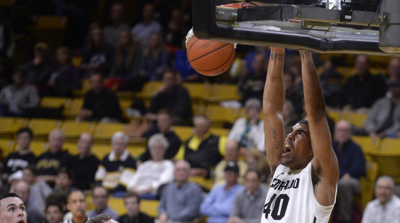 University of Colorado's Josh Scott dunks the ball over a group of Air Force Academy defenders during an NCAA college basketball game on Wednesday, Nov. 25, 2015 in Boulder, Colo. (Jeremy Papasso/The Daily Camera via AP)