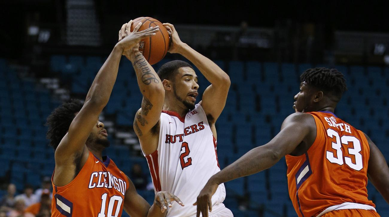 Clemson guard Gabe DeVoe, left, battles for the ball with Rutgers guard Bishop Daniels, center, and Clemson forward Josh Smith, right, during the second half of an NCAA college basketball game Wednesday, Nov. 25, 2015, in Las Vegas. (AP Photo/John Locher)