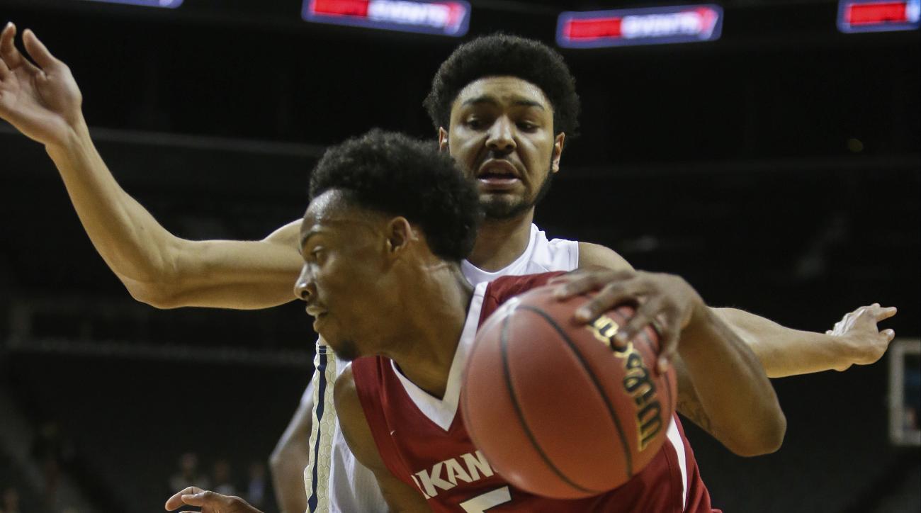 Arkansas's Anthlon Bell (5) drives past Georgia Tech's Josh Heath (11) during the first half of an NCAA college basketball game Thursday, Nov. 26, 2015, in New York. (AP Photo/Frank Franklin II)