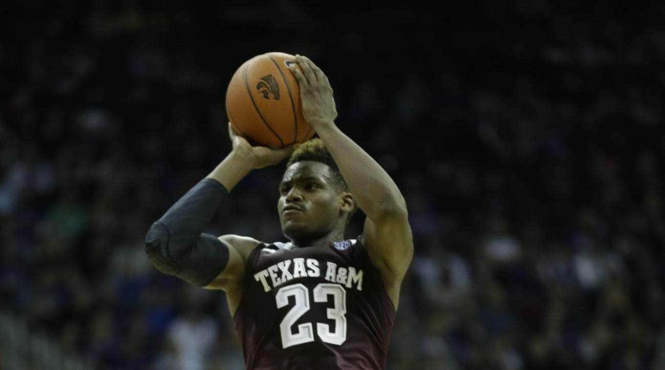 Texas A&M guard Danuel House (23) during the second half of an NCAA college basketball game against Kansas State at the Sprint Center in Kansas City, Mo., Saturday, Dec. 20, 2014. Kansas State defeated Texas A&M 71-64. (AP Photo/Orlin Wagner)