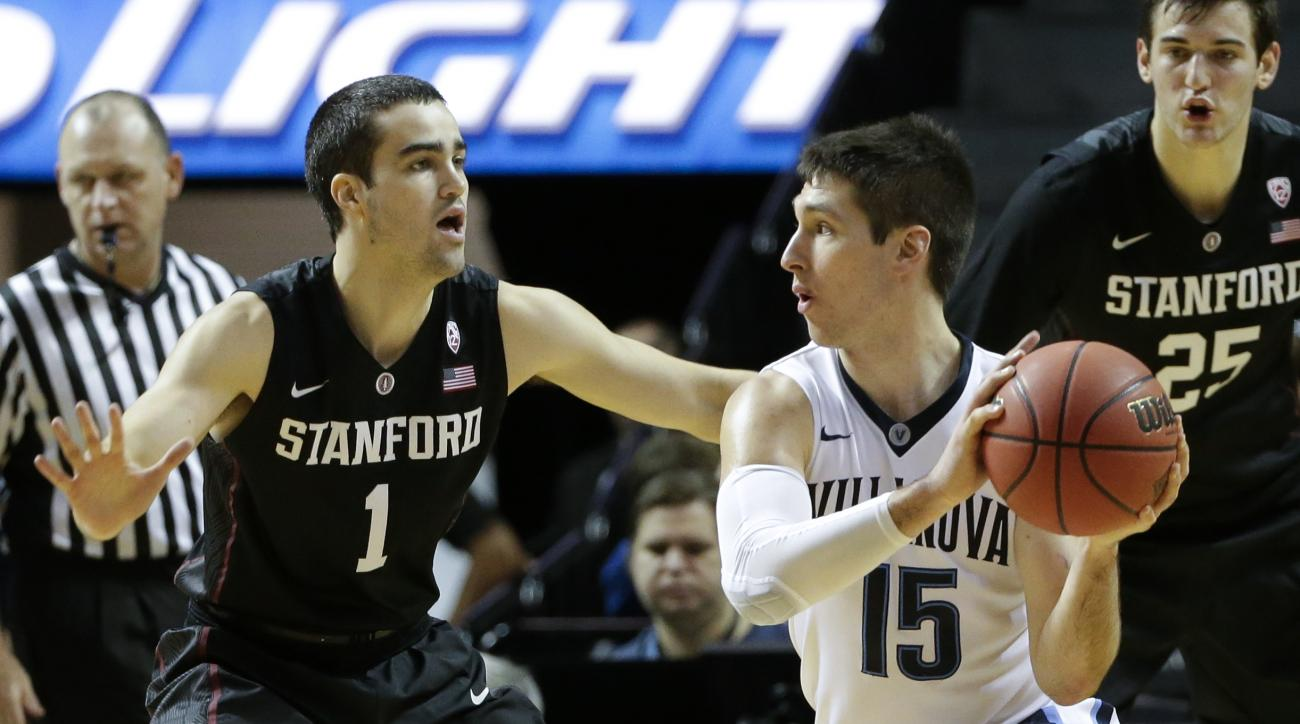 Stanford's Christian Sanders (1) defends against Villanova's Ryan Arcidiacono (15) during the first half of an NCAA college basketball game Thursday, Nov. 26, 2015, in New York. (AP Photo/Frank Franklin II)