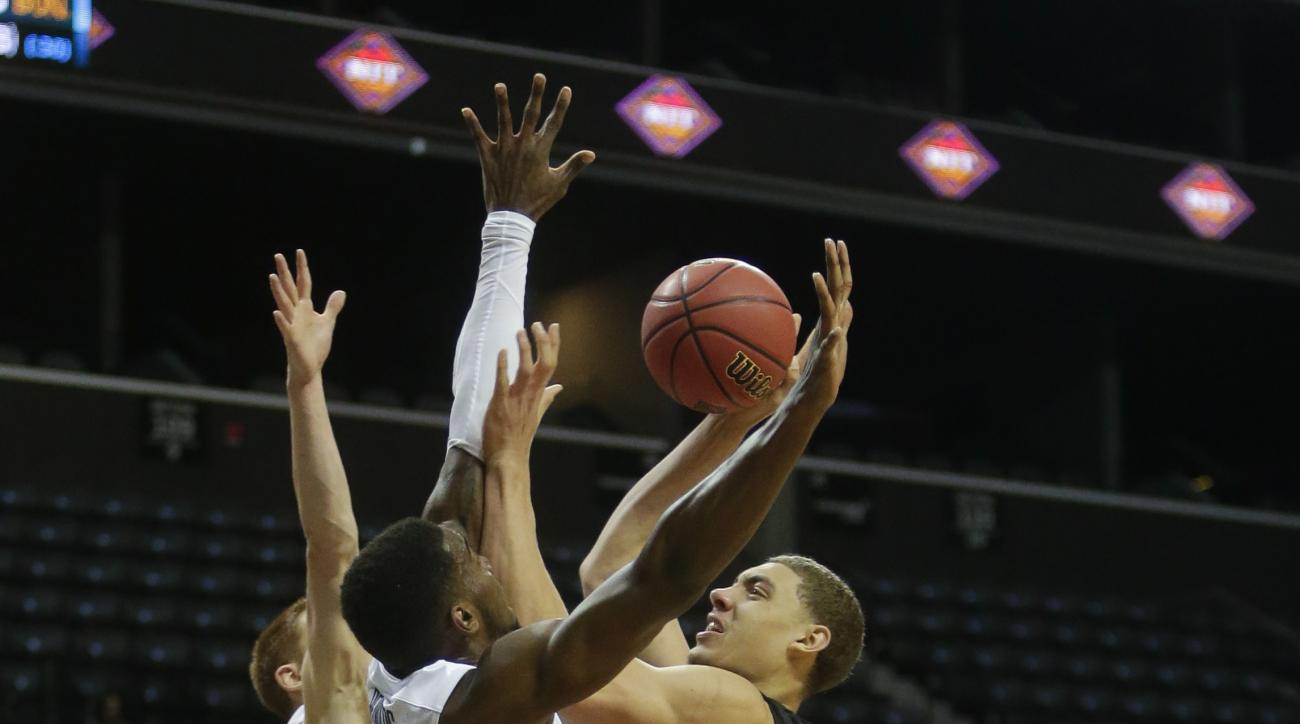 Stanford's Reid Travis (22) shoots over Villanova's Darryl Reynolds (45) and Donte DiVincenzo (10) during the first half of an NCAA college basketball game Thursday, Nov. 26, 2015, in New York. (AP Photo/Frank Franklin II)