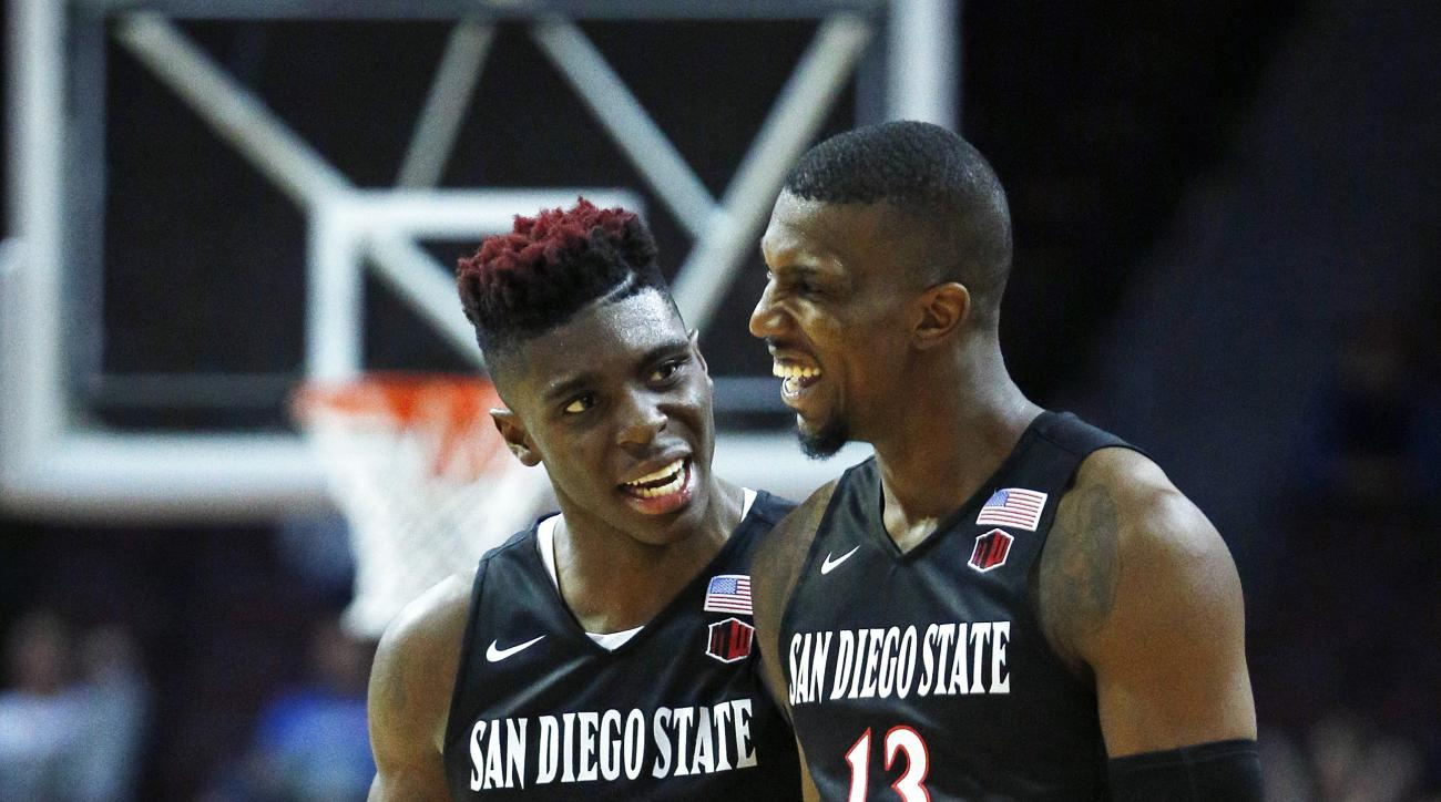 San Diego State forward Zylan Cheatham, left, and teammate Winston Shepard smile as they lead California during the second half of an NCAA college basketball game Thursday, Nov. 26, 2015, in Las Vegas. San Diego State won 72-58. (AP Photo/John Locher)