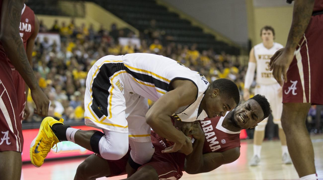 Alabama guard Retin Obasohan (32) fights for the rebound with Wichita State forward Anton Grady (15) during the first half of an NCAA college basketball game Friday, Nov. 27, 2015, in Orlando, Fla. (AP Photo/Willie J. Allen Jr.)