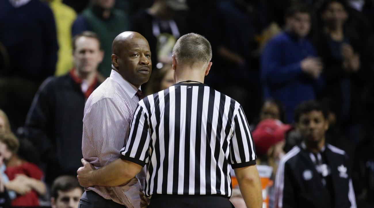 Arkansas head coach Mike Anderson is escorted away by a referee after getting a technical during the second half of an NCAA college basketball game against Stanford in the consolation round of the NIT Season Tip-Off tournament Friday, Nov. 27, 2015, in Ne