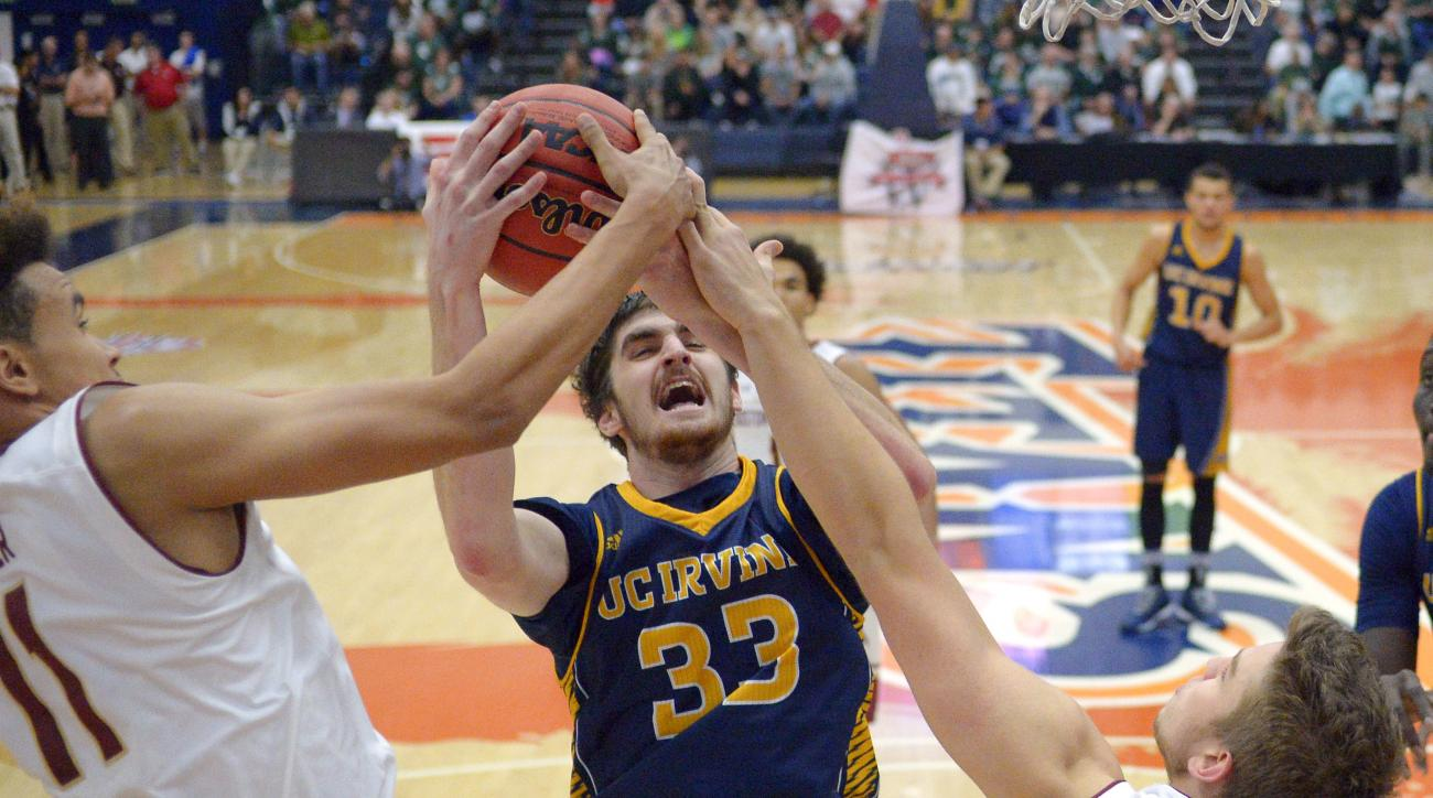 UC Irvine forward Mike Best, center, battles for the ball with Boston College forward A.J. Turner, left, and forward Ervins Meznieks during the second half of an NCAA college basketball game at the Wooden Legacy tournament, Friday, Nov. 27, 2015, in Fulle