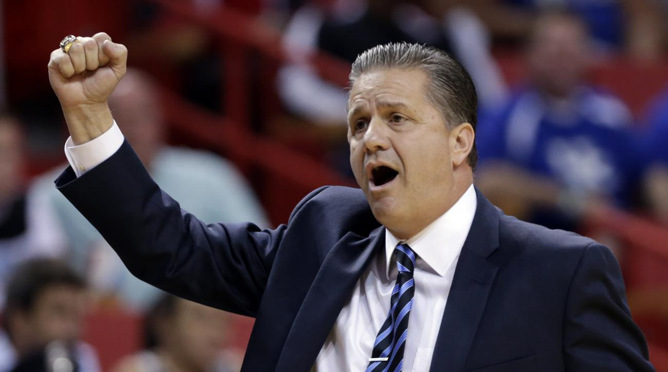 Kentucky head coach John Calipari  gestures in the first half of the Hoophall Miami Invitational NCAA college basketball tournament against South Florida, Friday, Nov. 27, 2015, in Miami. (AP Photo/Lynne Sladky)