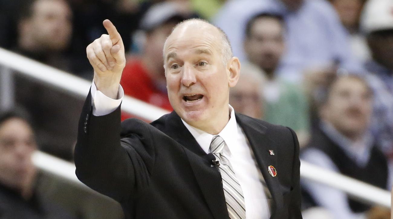 Northeastern head coach Bill Coen watches as his team plays against Notre Dame during the second half of an NCAA tournament second round college basketball game, Thursday, March 19, 2015, in Pittsburgh. (AP Photo/Gene J. Puskar)