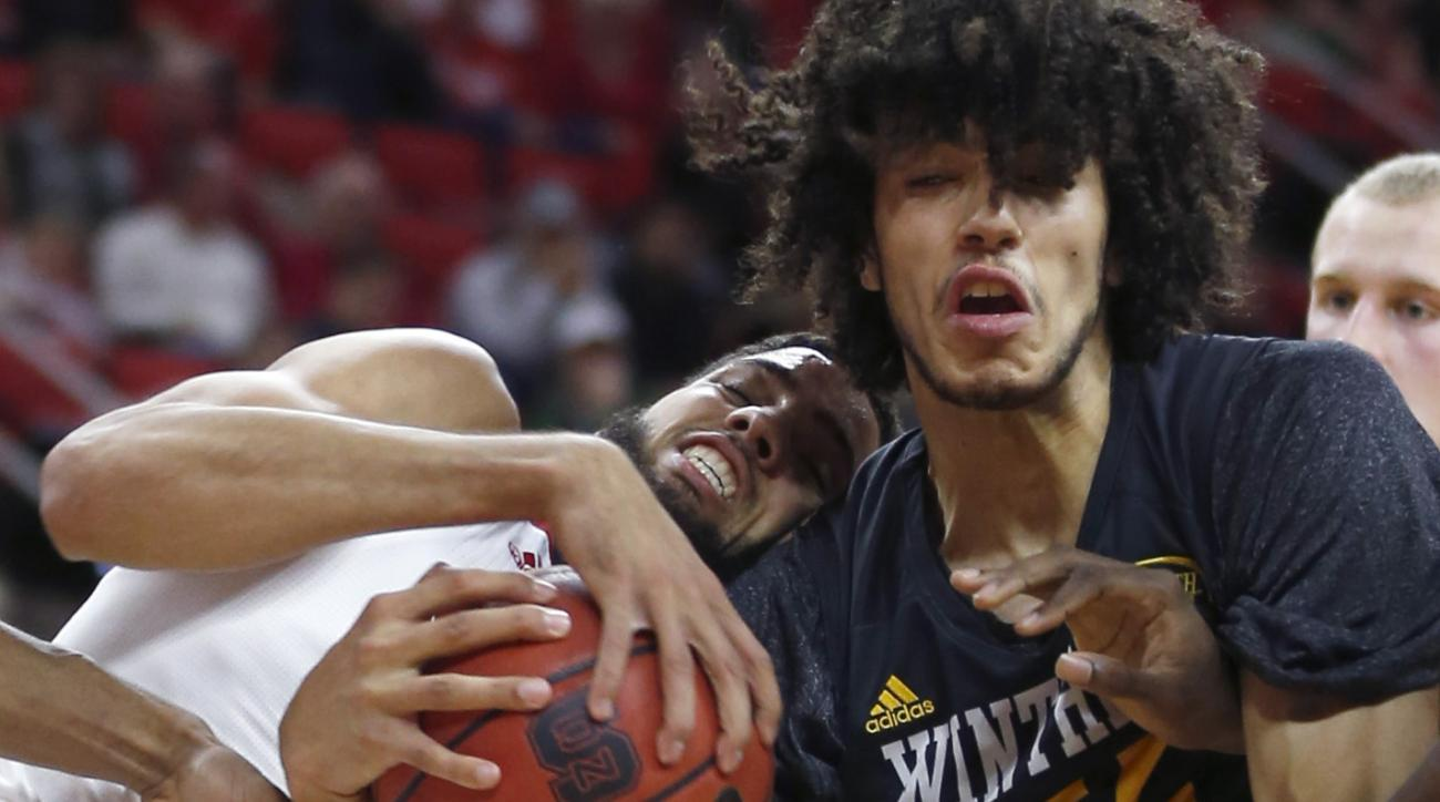 North Carolina State's Cody Martin, left, fights Winthrop's Xavier Cooks (12) for a rebound during the first half of an NCAA college basketball game Friday, Nov. 27, 2015, in Raleigh, N.C. (Ethan Hyman/The News & Observer via AP)