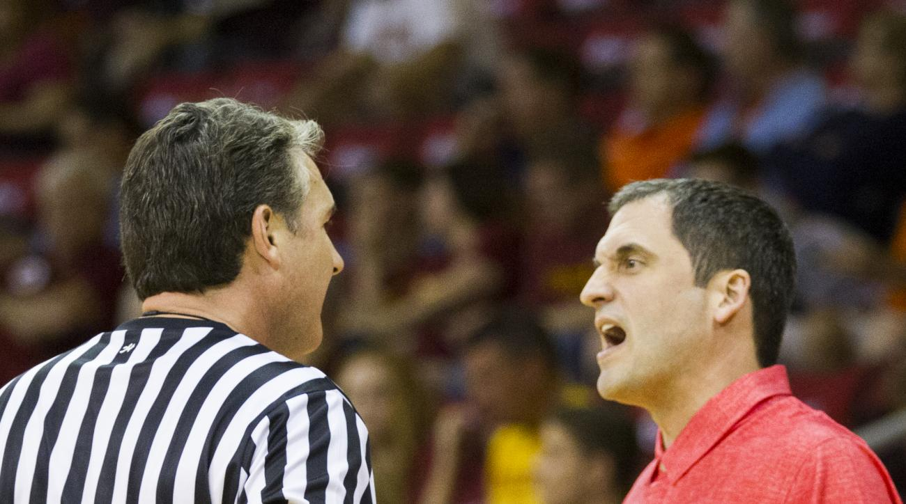 Iowa State head coach Steve Prohm talks to the referee in the first half of an NCAA college basketball game against Virginia Tech during the Emerald Coast Classic basketball tournament in Niceville, Fla., Friday, Nov. 27, 2015.  (AP Photo/Mark Wallheiser)