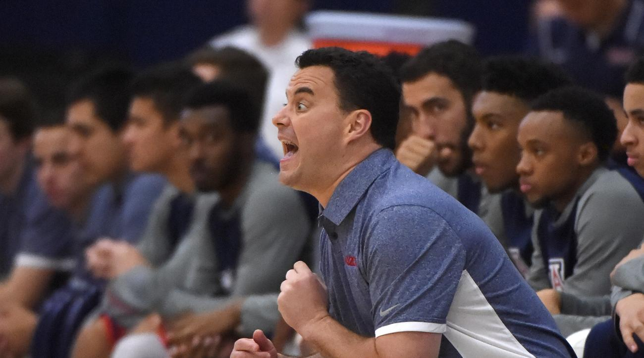 Arizona head coach Sean Miller yells to his team during the first half of an NCAA college basketball game against Providence at the Wooden Legacy tournament, Friday, Nov. 27, 2015, in Fullerton, Calif. (AP Photo/Mark J. Terrill)