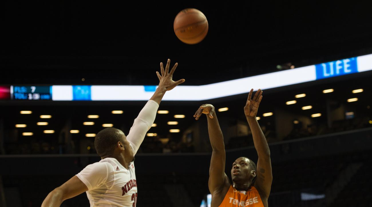 Tennessee guard Robert Hubbs III (3) takes a shot over Nebraska forward Ed Morrow (30) during the first half of an NCAA college basketball game in the consolation game at the Barclays Center Classic. Saturday, Nov. 28, 2015, in New York.  (AP Photo/Bryan