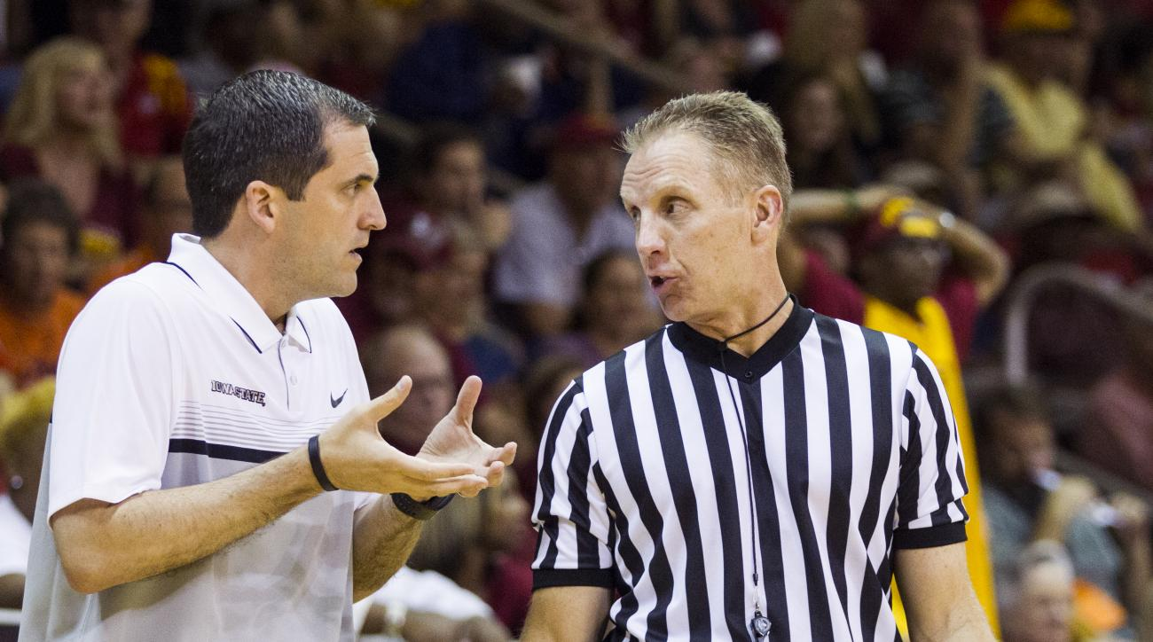 Iowa State head coach Steve Prohm talks to the referee in the first half of an NCAA college basketball game against Illinois during the Emerald Coast Classic in Niceville, Fla., Saturday, Nov. 28, 2015.  (AP Photo/Mark Wallheiser)