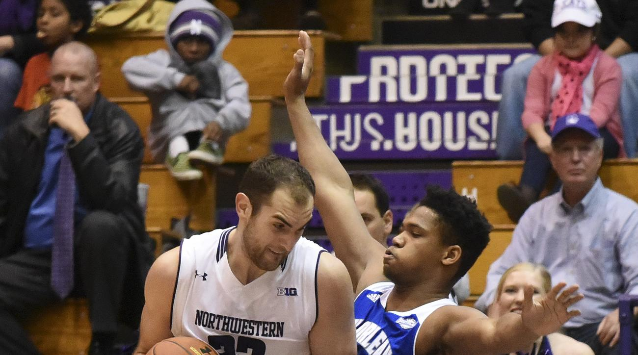 Northwestern center Alex Olah, left, drives against New Orleans forward Travin Thibodeaux during the first half of an NCAA college basketball game Saturday, Nov. 28, 2015, in Evanston Ill. (AP Photo/David Banks)