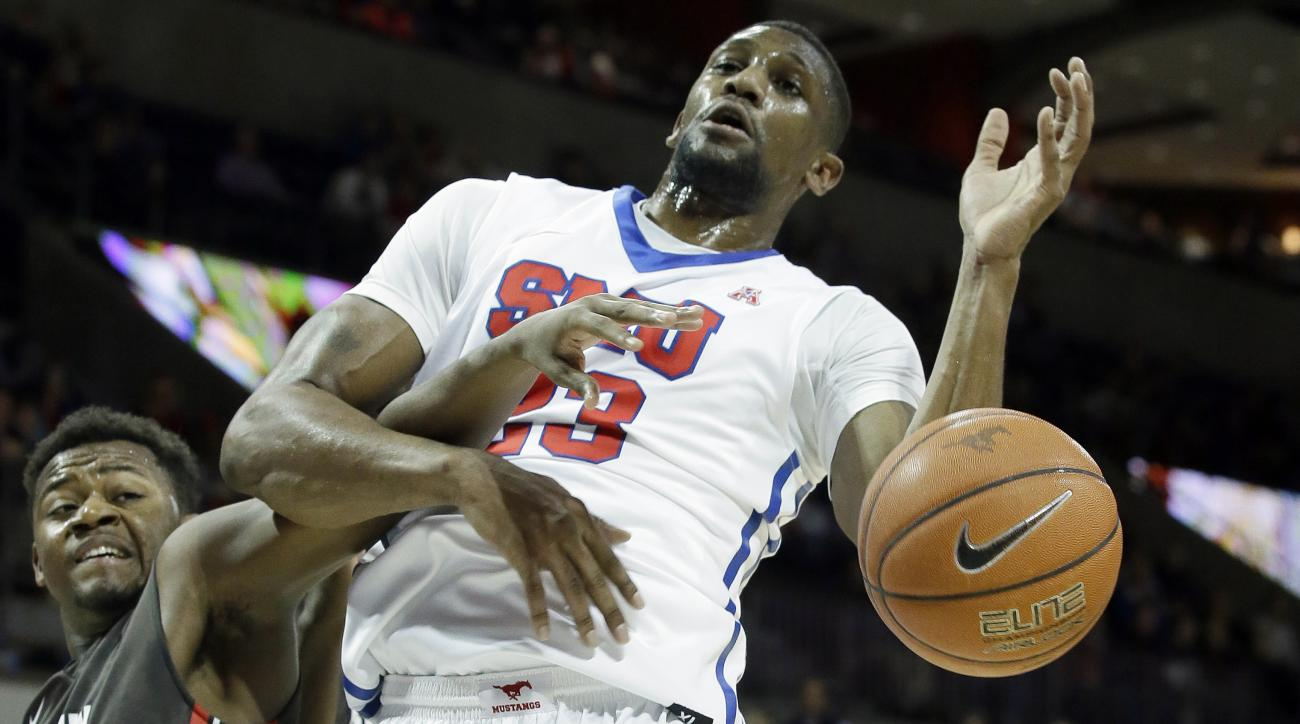 SMU forward Jordan Tolbert (23) and Brown guard Tavon Blackmon (5) tangle for control of the ball during the first half of an NCAA college basketball game Sunday, Nov. 29, 2015, in Dallas. (AP Photo/LM Otero)