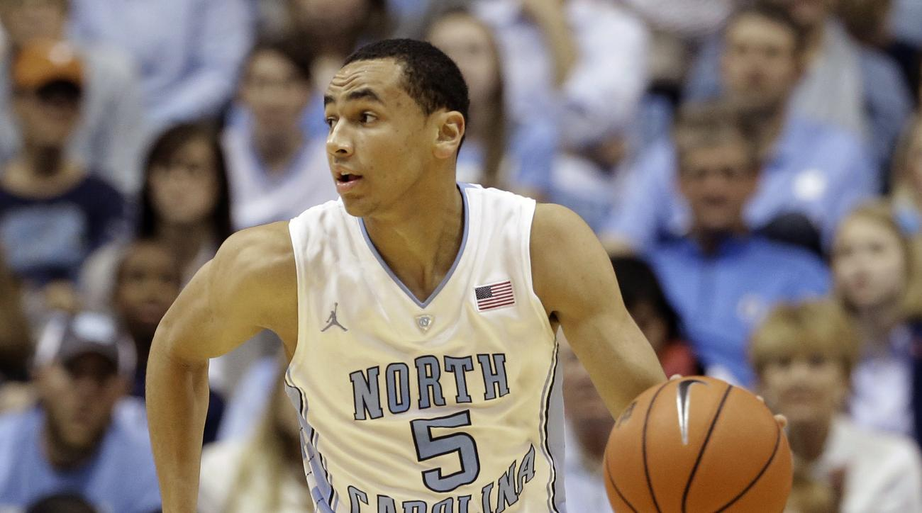 FILE - In this Dec. 18, 2013, file photo, North Carolina's Marcus Paige dribbles against Texas during the second half of an NCAA college basketball game in Chapel Hill, N.C. North Carolina is hoping senior Paige will be back in time from a broken hand tha