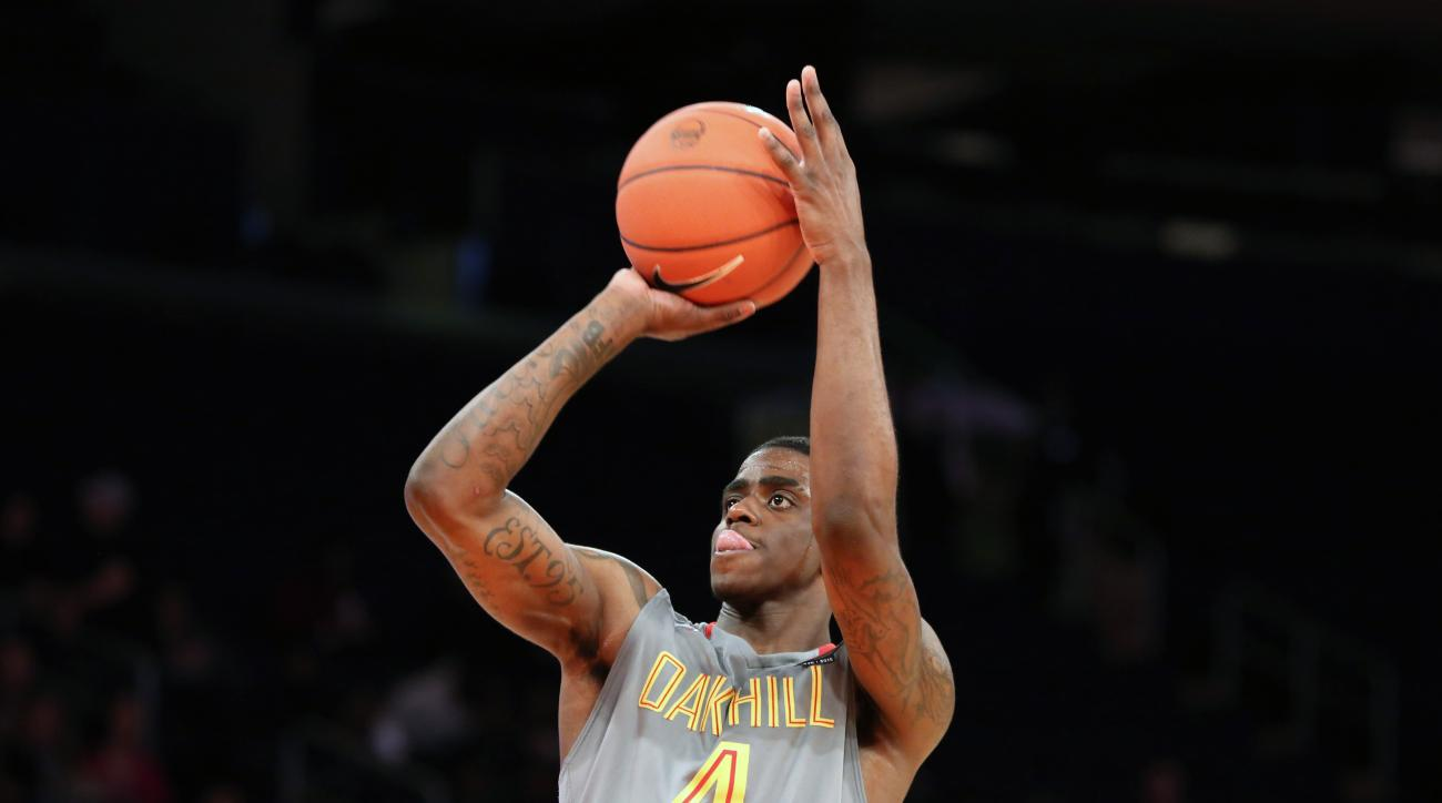 FILE- In this April 4, 2015, file photo, Oak Hill Academy's Dwayne Bacon shoots a free throw against Montverde Academy in the DICK'S Sporting Goods High School National Basketball Tournament Final in New York. The nation's top two freshmen scorers, Bacon