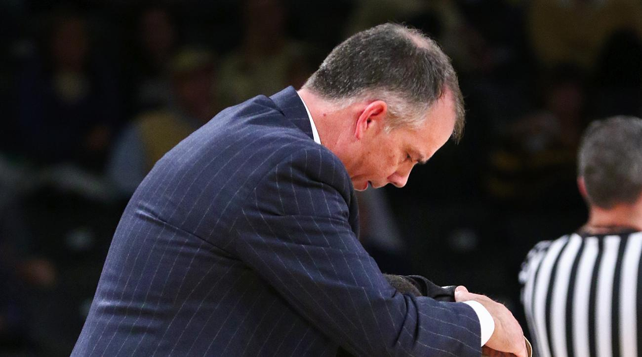 Wofford head coach Mike Young checks on his guard Jaylen Allen after he fell during an NCAA college basketball game against Georgia Tech, Tuesday, Dec. 1, 2015, in Atlanta. (Curtis Compton/Atlanta Journal-Constitution via AP)  MARIETTA DAILY OUT; GWINNETT