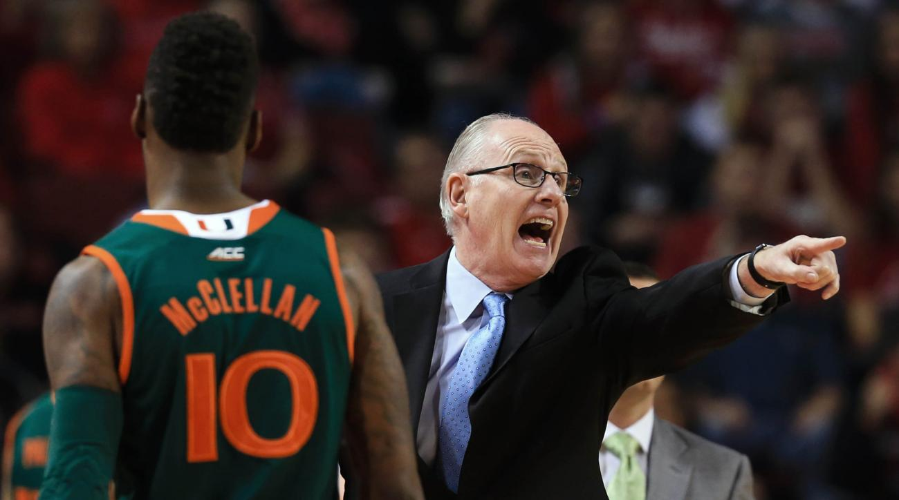 Miami coach Jim Larraaga yells instructions next to guard Sheldon McClellan (10) in the first half of an NCAA college basketball game against Nebraska in Lincoln, Neb., Tuesday, Dec. 1, 2015. (AP Photo/Nati Harnik)