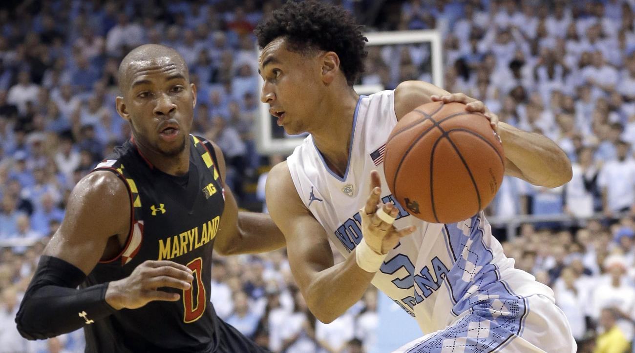 North Carolina's Marcus Paige (5) dribbles as Maryland's Rasheed Sulaimon (0) defends during the first half of an NCAA college basketball game in Chapel Hill, N.C., Tuesday, Dec. 1, 2015. (AP Photo/Gerry Broome)
