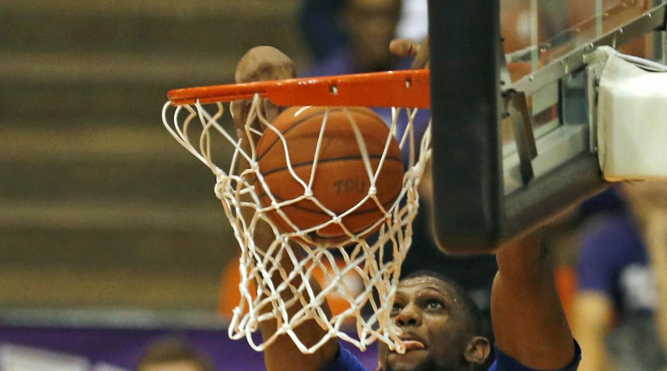 SMU forward Jordan Tolbert (23) dunks against TCU during the first half of an NCAA college basketball game Wednesday, Dec. 2, 2015, in Fort Worth, Texas. (AP Photo/Ron Jenkins)