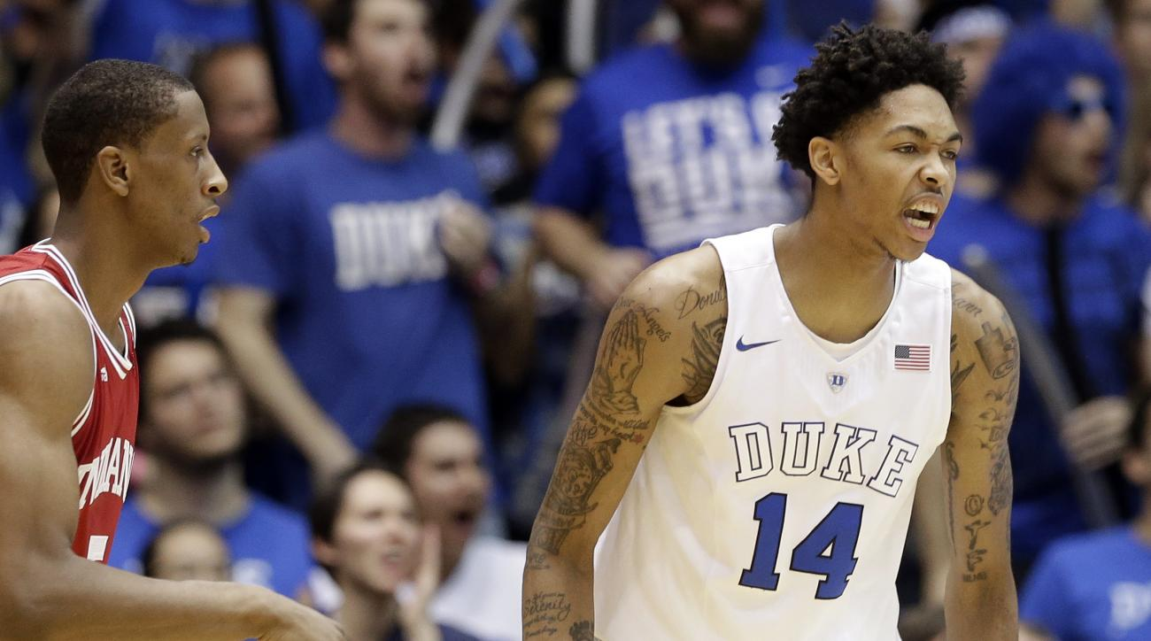 Duke's Brandon Ingram (14) reacts following a basket as Indiana's Troy Williams looks on at left during the first half of an NCAA college basketball game in Durham, N.C., Wednesday, Dec. 2, 2015. (AP Photo/Gerry Broome)
