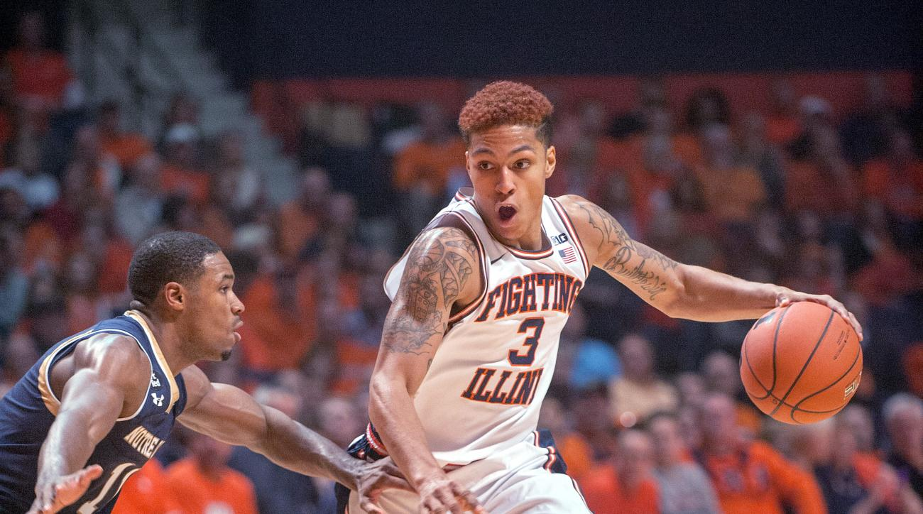 Illinois guard Khalid Lewis (3) looks to drive on Notre Dame guard Demetrius Jackson (11) in the first half of an NCAA College basketball game at the State Farm Center in Champaign, Ill., on Wednesday Dec. 2, 2015. (AP Photo/Rick Danzl)