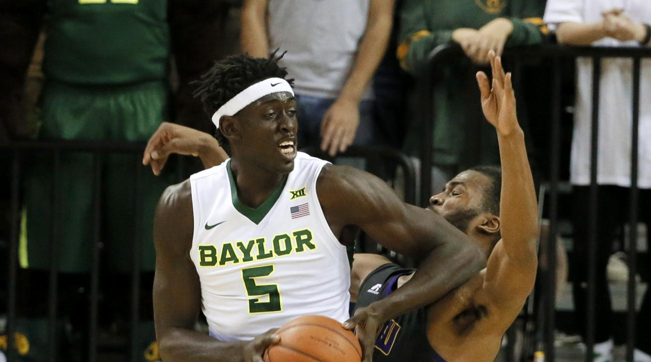 Baylor forward Johnathan Motley (5) lands an elbow on the chin of Prairie View A&M's Tyler Miller, right, as Motley positions for a shot attempt in the first half of an NCAA college basketball game, Wednesday, Dec. 2, 2015, in Waco, Texas. (AP Photo/Tony