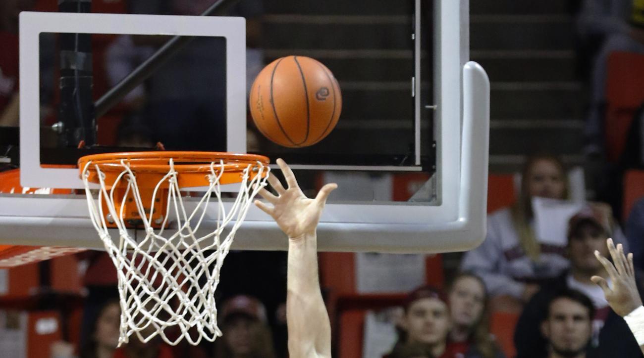 Oklahoma forward Ryan Spangler (00) shoots as Central Arkansas center Jake Zuilhof (52) watches during the first half of an NCAA college basketball game in Norman, Okla., Thursday, Dec. 3, 2015. (AP Photo/Alonzo Adams)