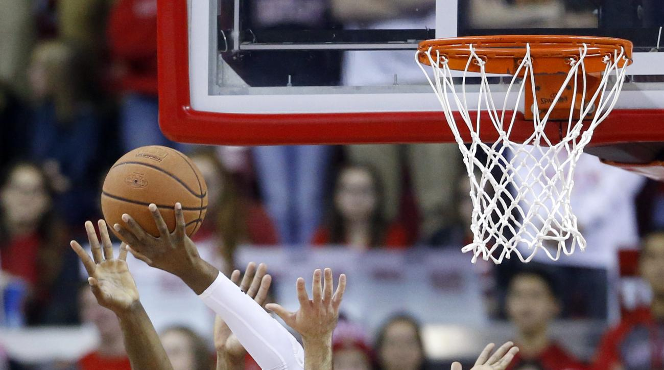 Maryland forward Robert Carter (4) shoots between St. Francis forwards Ronnie Drinnon (40) and Ifeanyi Umezurike, of Nigeria, in the first half of an NCAA college basketball game, Friday, Dec. 4, 2015, in College Park, Md. (AP Photo/Patrick Semansky)