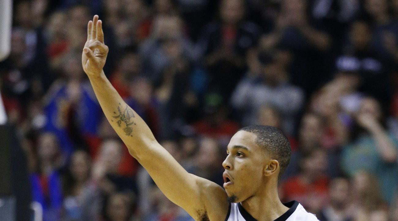UNLV guard Jalen Poyser celebrates after scoring a 3-point shot against Oregon during the first half of an NCAA college basketball game Friday, Dec. 4, 2015, in Las Vegas. (AP Photo/John Locher)