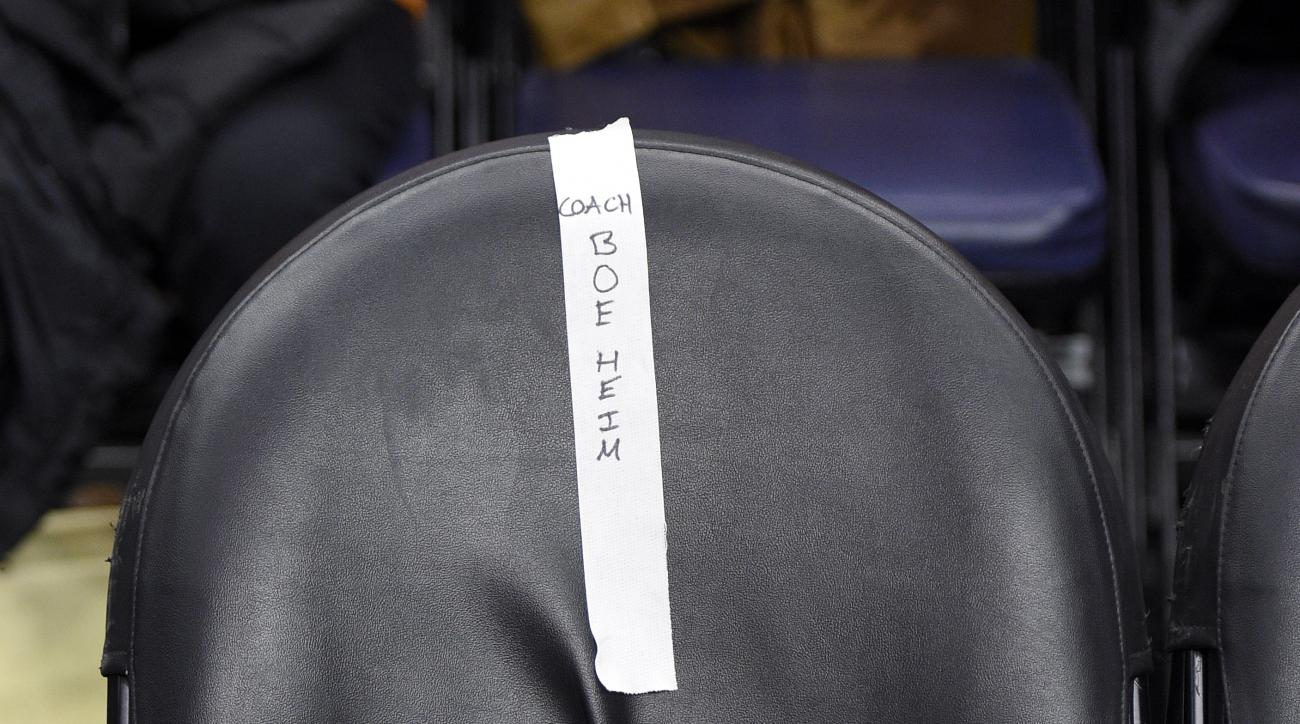 A chair with Syracuse head coach Jim Boeheim's name is seen on the Syracuse sideline during the half time of an NCAA college basketball game against Georgetown, Saturday, Dec. 5, 2015, in Washington. Boeheim is sitting out the game as the first of a nine-