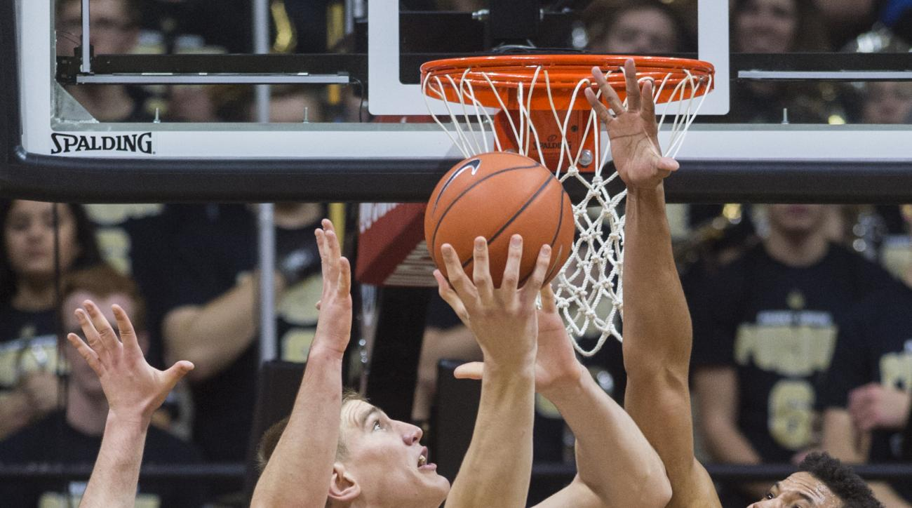Purdue center Isaac Haas (44) puts up a shot from under the basket as he's defended by New Mexico forward Tim Williams (32) and center Nikola Scekic (33) during the first half of an NCAA college basketball game, Saturday, Dec. 5, 2015, in West Lafayette,