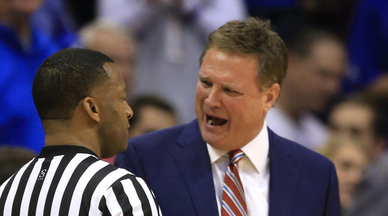 Kansas head coach Bill Self, right, talks with a game official during the first half of an NCAA college basketball game against Harvard in Lawrence, Kan., Saturday, Dec. 5, 2015. (AP Photo/Orlin Wagner)
