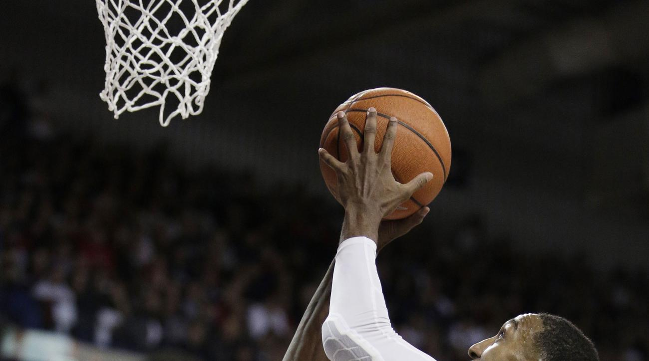Gonzaga's Eric McClellan shoots in front of Arizona's Ryan Anderson (12) during the first half of an NCAA college basketball game, Saturday, Dec. 5, 2015, in Spokane, Wash. (AP Photo/Young Kwak)