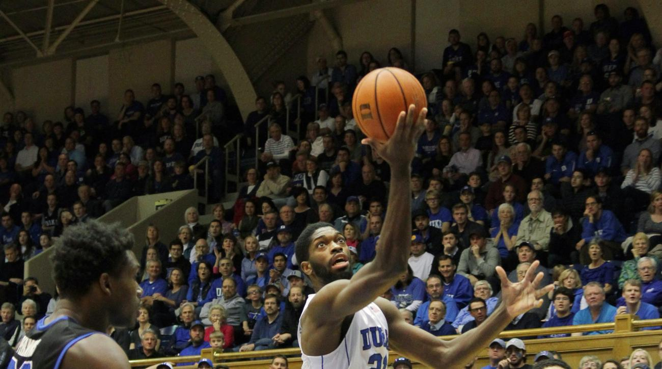 Duke's Amile Jefferson shoots between Buffalo's Nick Perkins, left, and CJ Massinburg during an NCAA college basketball game in Durham, N.C., Saturday, Dec. 5, 2015.  (AP Photo/Ted Richardson)