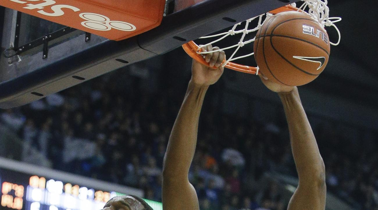 Xavier's James Farr (2) dunks on Western Kentucky's Nigel Snipes (21) in the first half of an NCAA college basketball game, Saturday, Dec. 5, 2015, in Cincinnati. (AP Photo/John Minchillo)