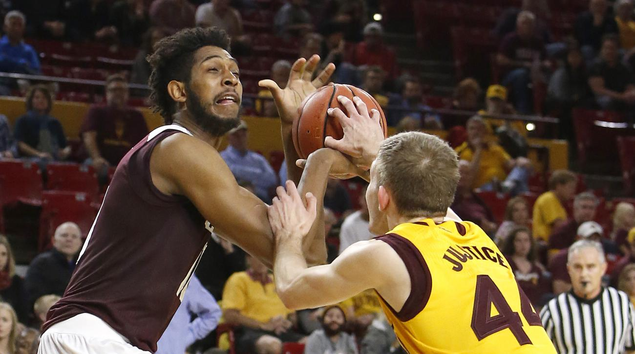 Texas A&M center Tonny Trocha-Morelos, left, and Arizona State guard Kodi Justice battle for the ball during the first half of an NCAA college basketball game, Saturday, Dec. 5, 2015, in Tempe, Ariz. (AP Photo/Rick Scuteri)