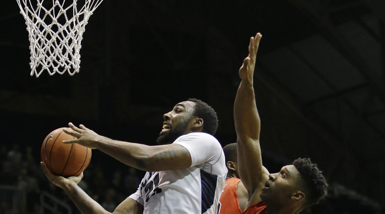Butler's Roosevelt Jones shoots against VMI's Phillip Anglade during the first half of an NCAA college basketball game Monday, Dec. 7, 2015, in Indianapolis. (AP Photo/Darron Cummings)