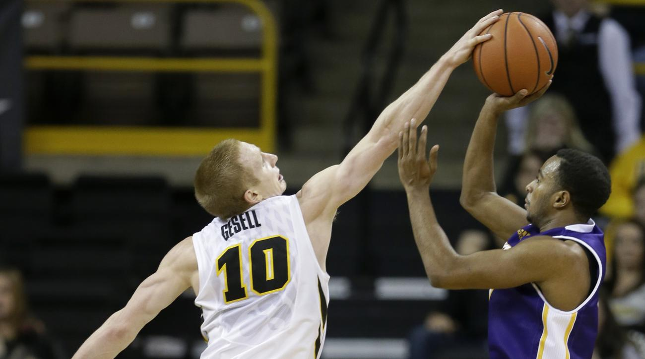 Iowa guard Mike Gesell, left,  blocks a shot by Western Illinois guard Jabari Sandifer, right, during the second half of an NCAA college basketball game, Monday, Dec. 7, 2015, in Iowa City, Iowa. Iowa won 90-56. (AP Photo/Charlie Neibergall)